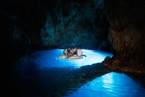 Natural light below the surface inside the Blue cave Bisevo