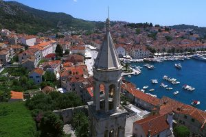 Cathedral with bell tower and view of the port, Hvar town